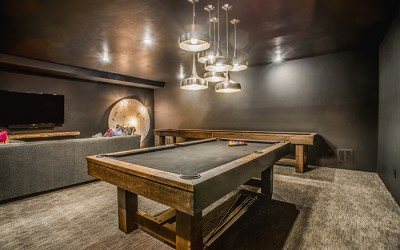 Beautifully illuminated game room with a pool table.