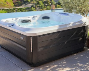 Outdoor hot tub installation on a patio in the spring.