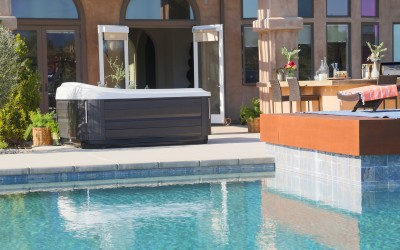 Outdoor hot tub by a pool